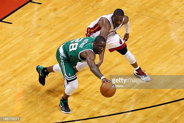 Mickael Pietrus of the Boston Celtics attempts to steal the ball in the first half against Dwyane Wade of the Miami Heat in Game Five of the Eastern...