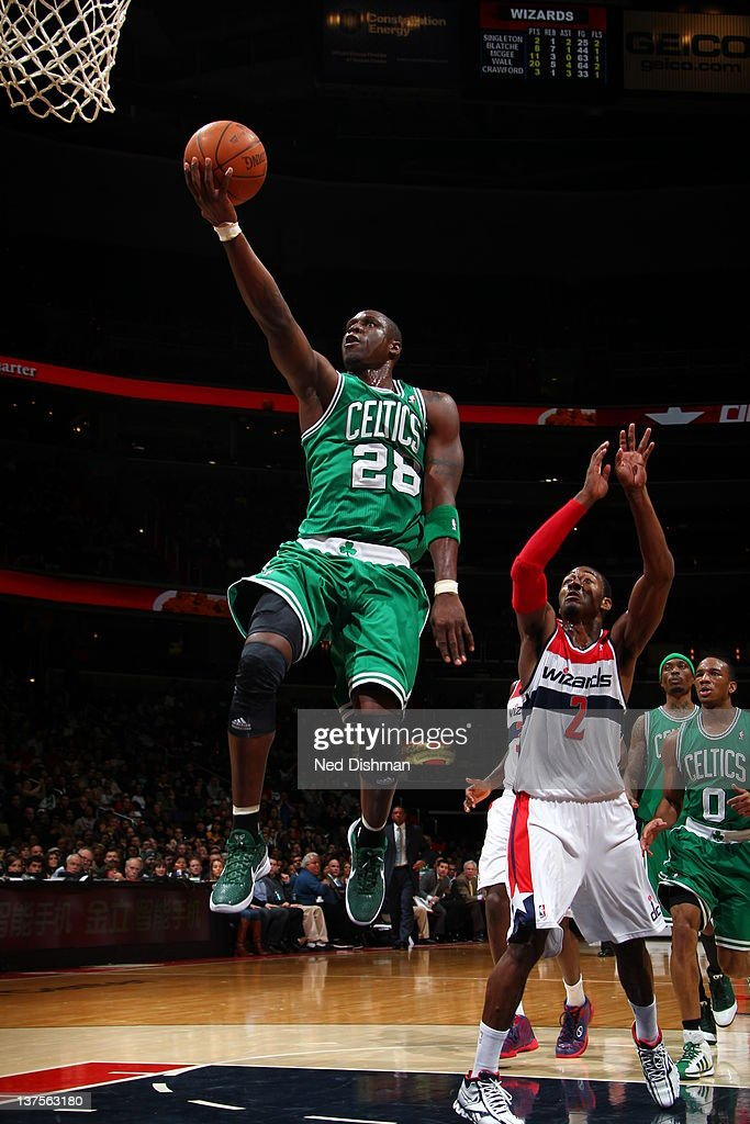 <a gi-track='captionPersonalityLinkClicked' href=/galleries/search?phrase=Mickael+Pietrus&family=editorial&specificpeople=202910 ng-click='$event.stopPropagation()'>Mickael Pietrus</a> #28 of the Boston Celtics goes to the basket against <a gi-track='captionPersonalityLinkClicked' href=/galleries/search?phrase=John+Wall&family=editorial&specificpeople=2265812 ng-click='$event.stopPropagation()'>John Wall</a> #2 of the Washington Wizards during the game between the Washington Wizards and the Boston Celtics at the Verizon Center on January 22, 2012 in Washington, DC.