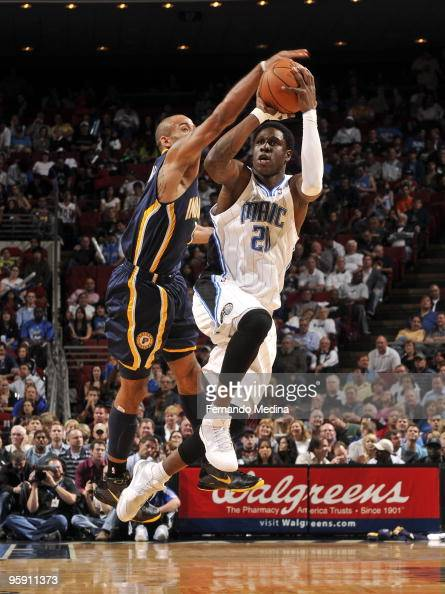 Mickael Pietrus of the Orlando Magic attempts a threepoint shot against Dahntay Jones of the Indiana Pacers during the game on January 20 2010 at...