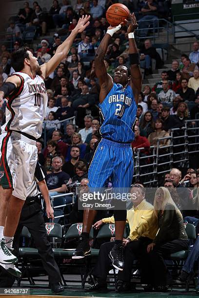 Mickael Pietrus of the Orlando Magic shoots under pressure against Carlos Delfino of the Milwaukee Bucks during the game on November 28 2009 at the...