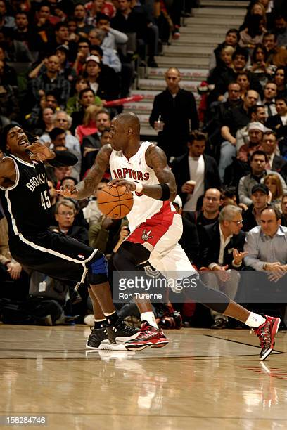 Mickael Pietrus of the Toronto Raptors drives against Gerald Wallace of the Brooklyn Nets on December 12 2012 at the Air Canada Centre in Toronto...
