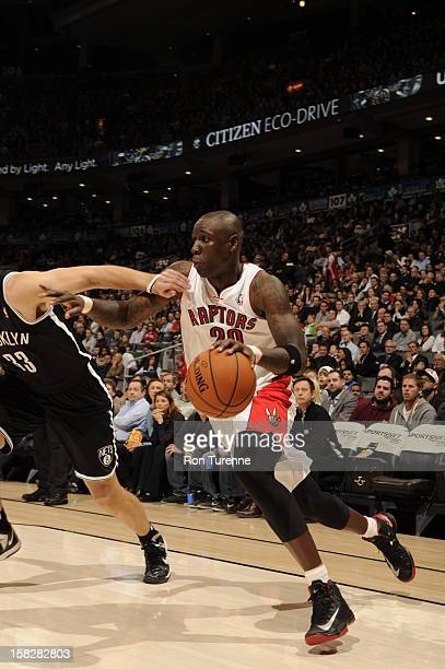 Mickael Pietrus of the Toronto Raptors drives against Mirza Teletovic of the Brooklyn Nets on December 12 2012 at the Air Canada Centre in Toronto...