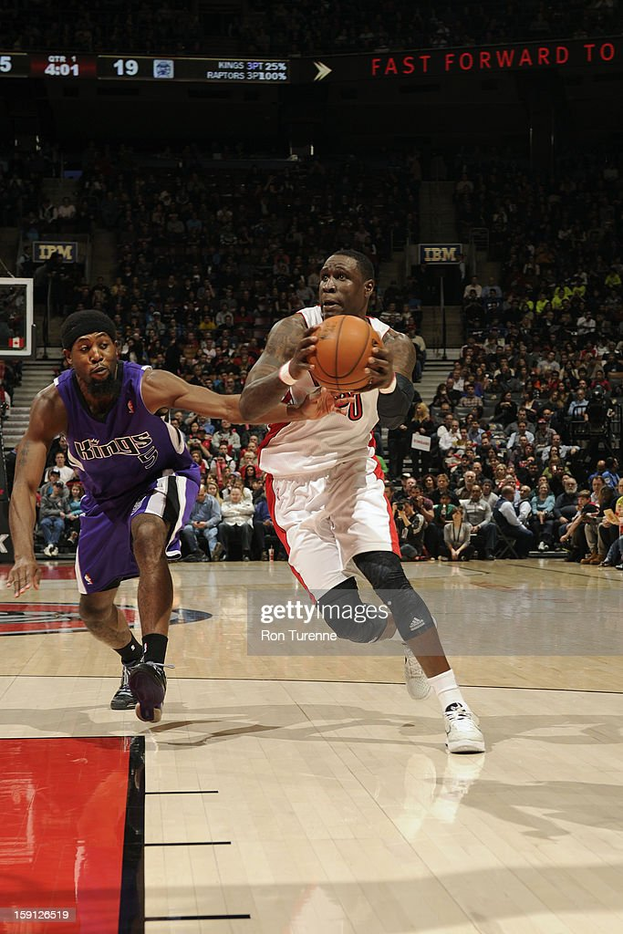 Mickael Pietrus #20 of the Toronto Raptors drives to the basket against the Sacramento Kings on January 4, 2013 at the Air Canada Centre in Toronto, Ontario, Canada.