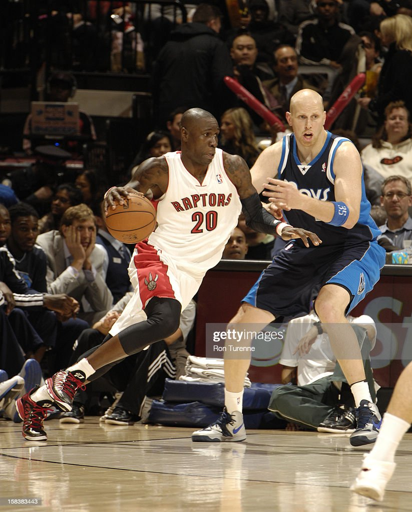 <a gi-track='captionPersonalityLinkClicked' href=/galleries/search?phrase=Mickael+Pietrus&family=editorial&specificpeople=202910 ng-click='$event.stopPropagation()'>Mickael Pietrus</a> #20 of the Toronto Raptors drives to the basket around <a gi-track='captionPersonalityLinkClicked' href=/galleries/search?phrase=Chris+Kaman&family=editorial&specificpeople=201661 ng-click='$event.stopPropagation()'>Chris Kaman</a> #35 of the Dallas Mavericks on December 14, 2012 at the Air Canada Centre in Toronto, Ontario, Canada.