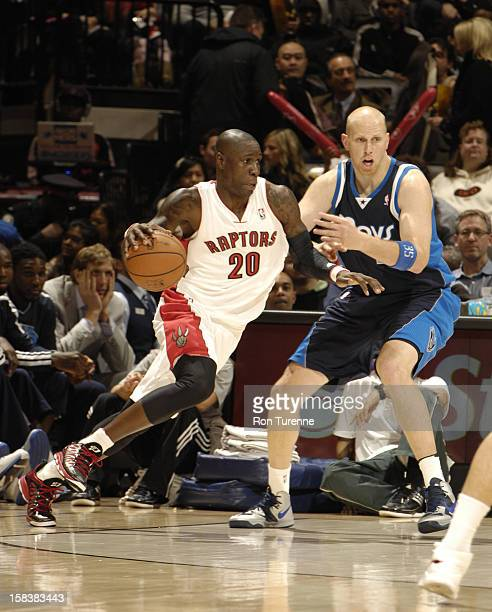 Mickael Pietrus of the Toronto Raptors drives to the basket around Chris Kaman of the Dallas Mavericks on December 14 2012 at the Air Canada Centre...