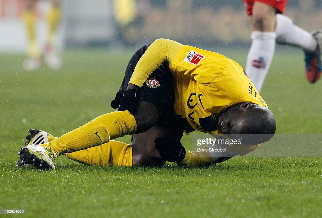 <a gi-track='captionPersonalityLinkClicked' href=/galleries/search?phrase=Mickael+Pote&family=editorial&specificpeople=4453172 ng-click='$event.stopPropagation()'>Mickael Pote</a> of Dresden falls injured to the pitch during the Second Bundesliga match between SG Dynamo Dresden and 1. FC Koeln at Gluecksgas-Stadion on March 18, 2013 in Dresden, Germany.