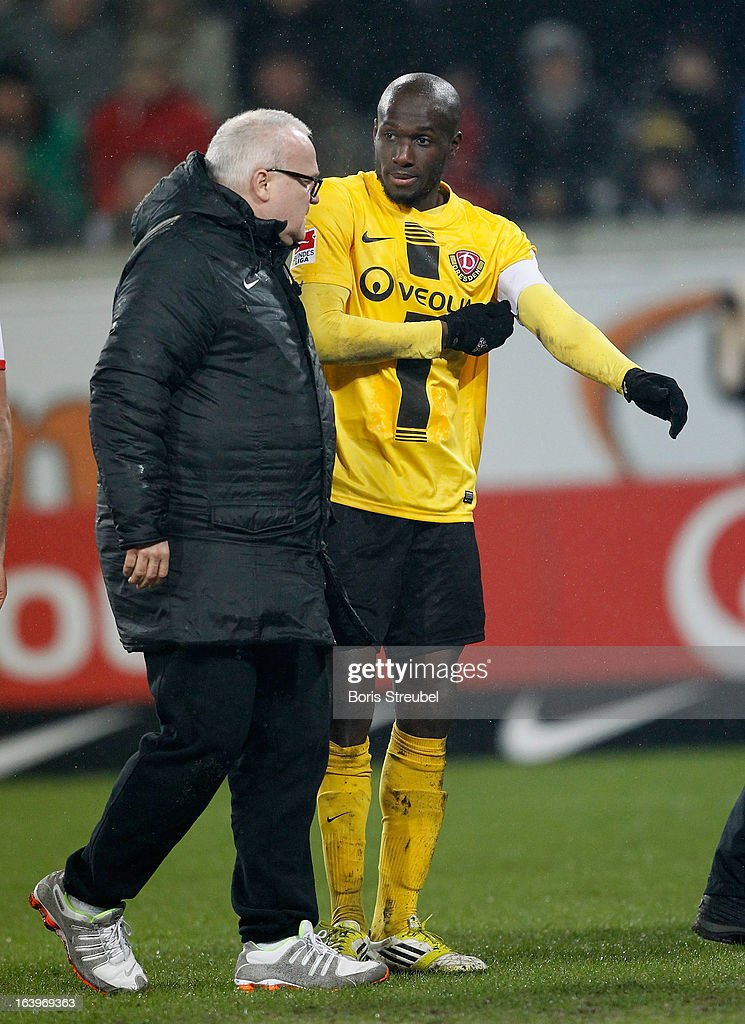 Mickael Pote (R) of Dresden leaves injured the pitch during the Second Bundesliga match between SG Dynamo Dresden and 1. FC Koeln at Gluecksgas-Stadion on March 18, 2013 in Dresden, Germany.
