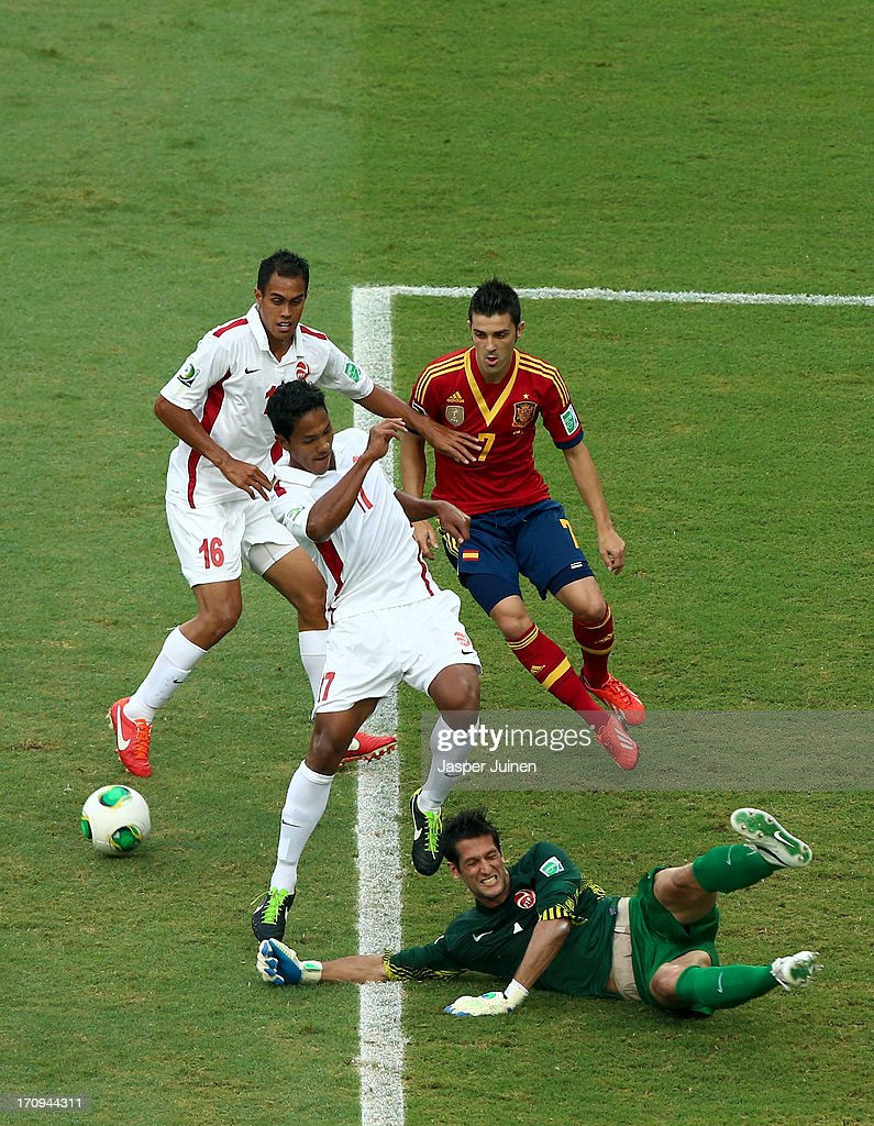 Mickael Roche of Tahiti dives to make a save at the feet of David Villa of Spain during the FIFA Confederations Cup Brazil 2013 Group B match between Spain and Tahiti at the Maracana Stadium on June 20, 2013 in Rio de Janeiro, Brazil.