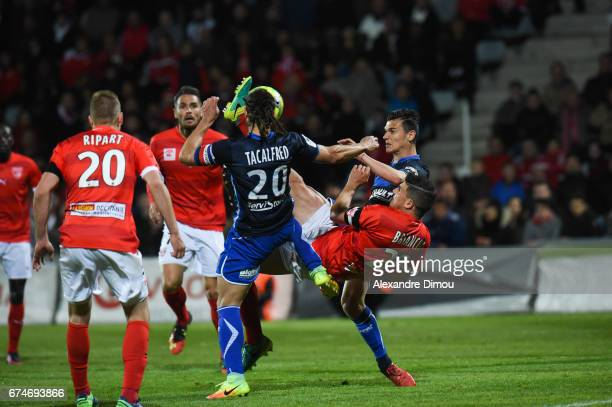 Mickael Tacalfred and Loic Goujon of Auxerre and Anthony Briancon of Nimes during the French Ligue 2 match between Nimes and Auxerre on April 28 2017...