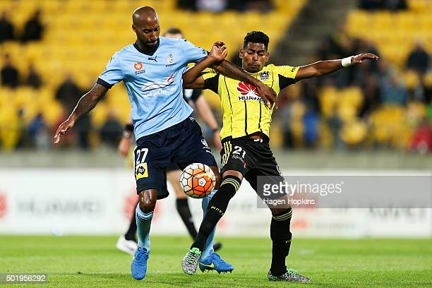 Mickael Tavares of Sydney FC and Roy Krishna of the Phoenix compete for the ball during the round 11 ALeague match between the Wellington Phoenix and...