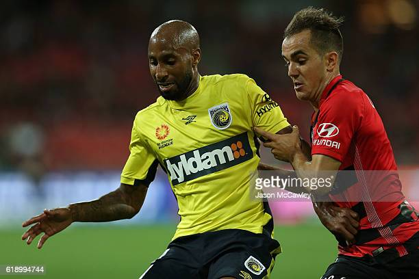 Mickael Tavares of the Mariners is challenged by Steven Lustica of the Wanderers during the round four ALeague match between the Western Sydney...