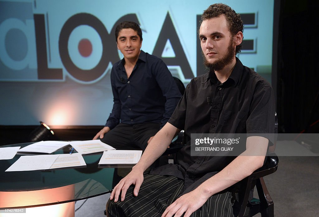Mickael (R), who was arrested for allegedly attacking a police officer who stopped his wife over her full-face veil, poses before taking part in a broadcast show on a local TV in Pantin, a Paris suburb, on July 23, 2013. A weekend of violence in the suburban city of Trappes erupted after Mickael was detained, as some 400 people protested near the police station. France has banned women from wearing full-face veils in public since April 2011, and authorities say about 300 women were caught breaking the law in the first year it was in force.