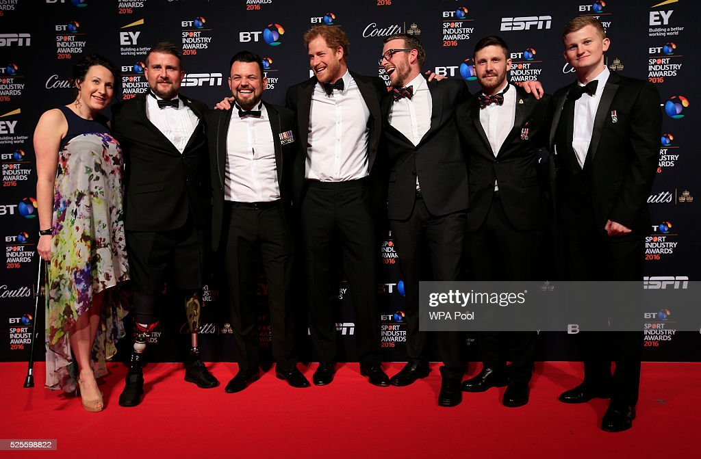 Mickaela Richards, Stuart Robinson, Paul Vice, Prince Harry, JJ Chalmers, Luke Darlington and Sam Stocks on the red carpet at the BT Sport Industry Awards 2016 at Battersea Evolution on April 28, 2016 in London, England. The BT Sport Industry Awards is the most prestigious commercial sports awards ceremony in Europe, where over 1750 of the industry's key decision-makers mix with high profile sporting celebrities for the most important networking occasion in the sport business calendar.
