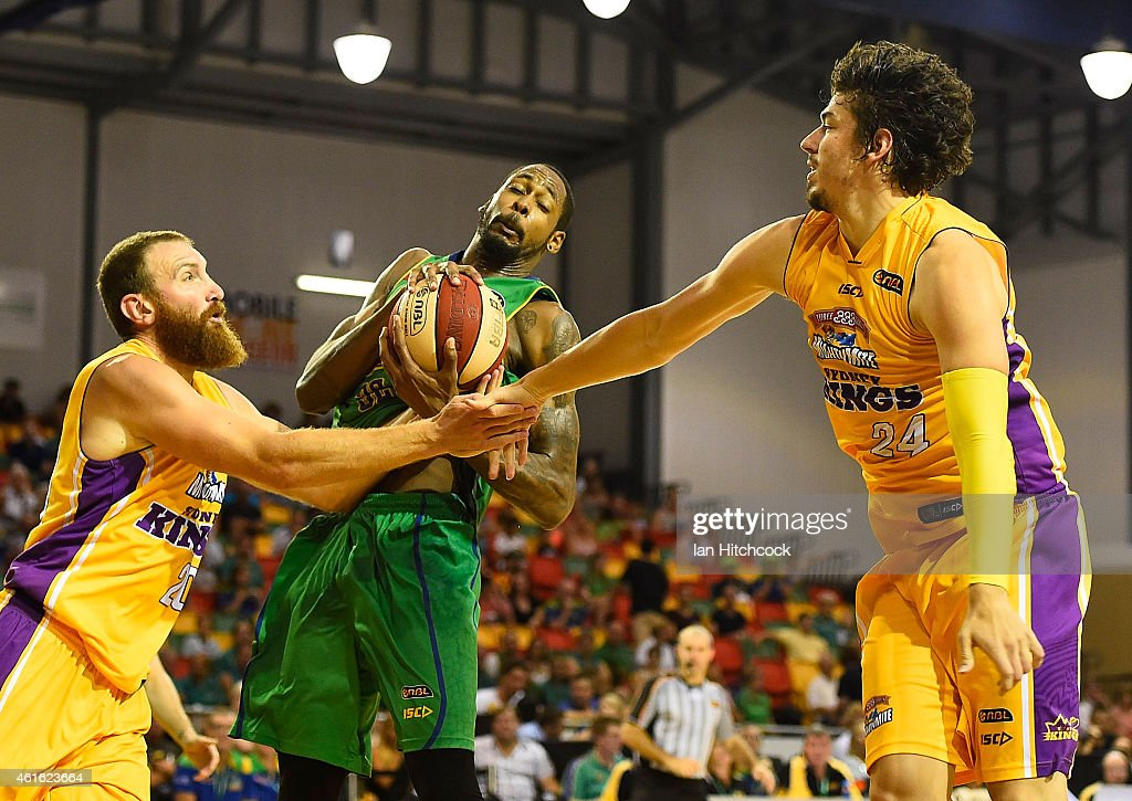 Mickell Gladness of the Crocodiles collects a re-bound in front of Cody Ellis of the Kings during the round 15 NBL match between the Townsville Crocodiles and Sydney Kings at Townsville RSL Stadium on January 16, 2015 in Townsville, Australia.