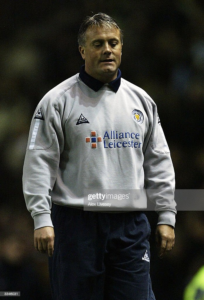 Mickey Adams, the manager of Leicester City walks off dejected after defeat by Manchester United in the FA Barclaycard Premiership match between Manchester United and Leicester City at Old Trafford on April 13, 2004 in Manchester, England.