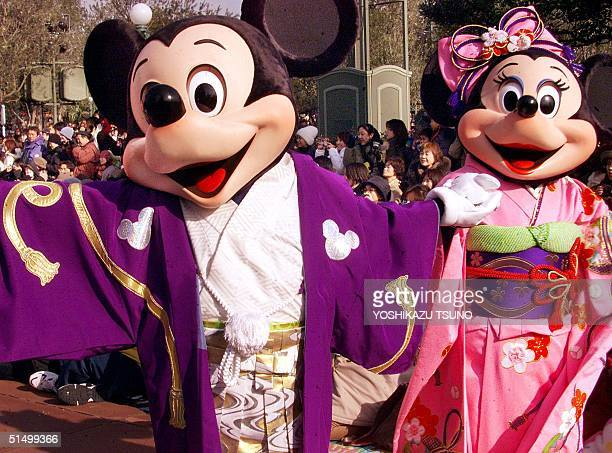 Mickey and Minnie Mouse in traditional Japanese kimono greet the guests for the New Year celebration at the Tokyo Disneyland in Urayasu suburban...