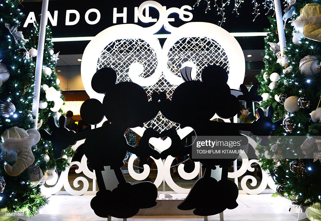 A Mickey and Minnie Mouse light display is displayed outside a shopping mall as a part of decorations ahead of Christmas in Tokyo on December 22, 2012. Although Christians only account for around only one percent of Japan's population,, people usually celebrate Christmas by spending time with their sweethearts and exchanging gifts. AFP PHOTO / TOSHIFUMI KITAMURA