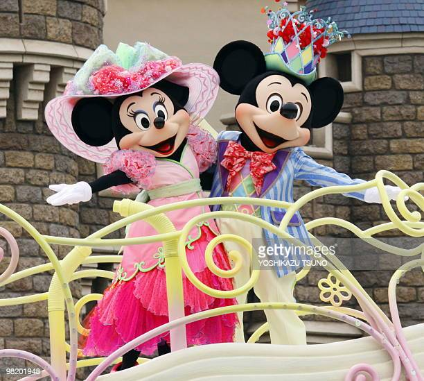 Mickey and Minnie Mouse perform on a float during the press preview for the new parade 'Disney Easter Wonderland' at the Tokyo Disneyland at Urayasu...