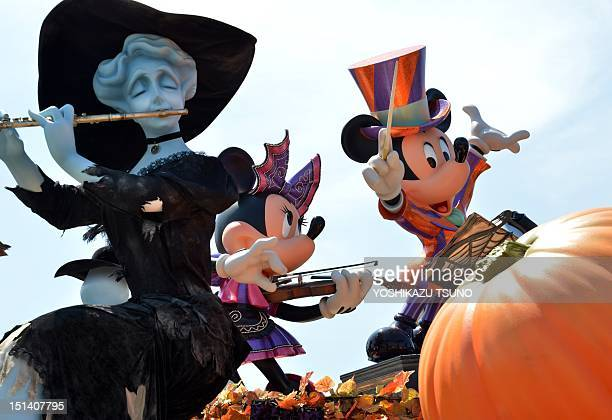 Mickey and Minnie Mouse statues are dressed up for Halloween at the Tokyo Disneyland in Tokyo on September 7 2012 Tokyo's Disney theme park runs...