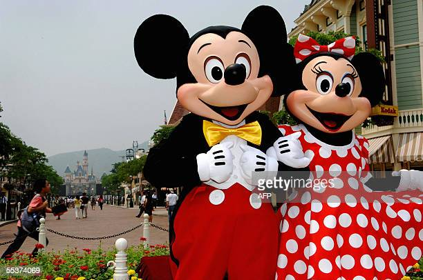 Mickey and Minnie Mouse walk around the Main Street of Hong Kong Disneyland during a preview of the park in Hong Kong 11 September 2005 Hong Kong has...