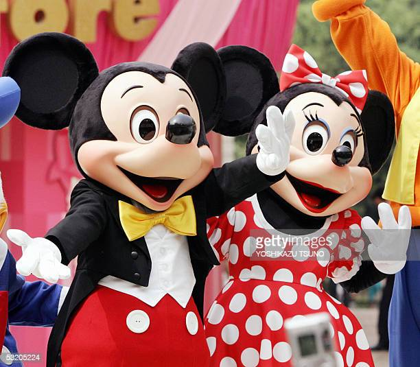 Mickey and Minnie Mouse wave to the audience as they celebrate the fifth anniversary of the Japanese flag shop of Disney Store at a shopping mall...