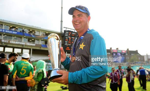 Mickey Arthur Head Coach of Pakistan celebrates with the trophy during the ICC Champions Trophy Final match between India and Pakistan at The Kia...