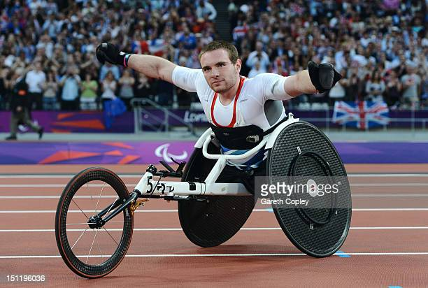 Mickey Bushell of Great Britain celebrates winning gold in the Men's 100m T53 Final on day 5 of the London 2012 Paralympic Games at Olympic Stadium...