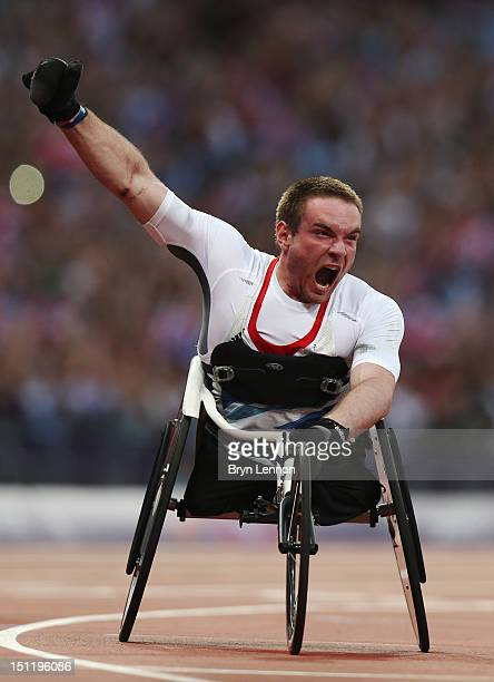 Mickey Bushell of Great Britain crosses the line to win gold in the Men's 100m T53 Final on day 5 of the London 2012 Paralympic Games at Olympic...