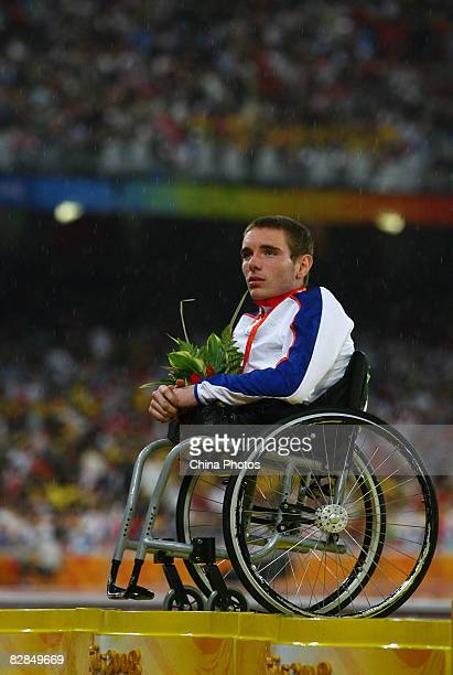 Mickey Bushell of Great Britain is shown after winning the silver medal in the Men's 100m T53 Final Athletics event at the National Stadium during...