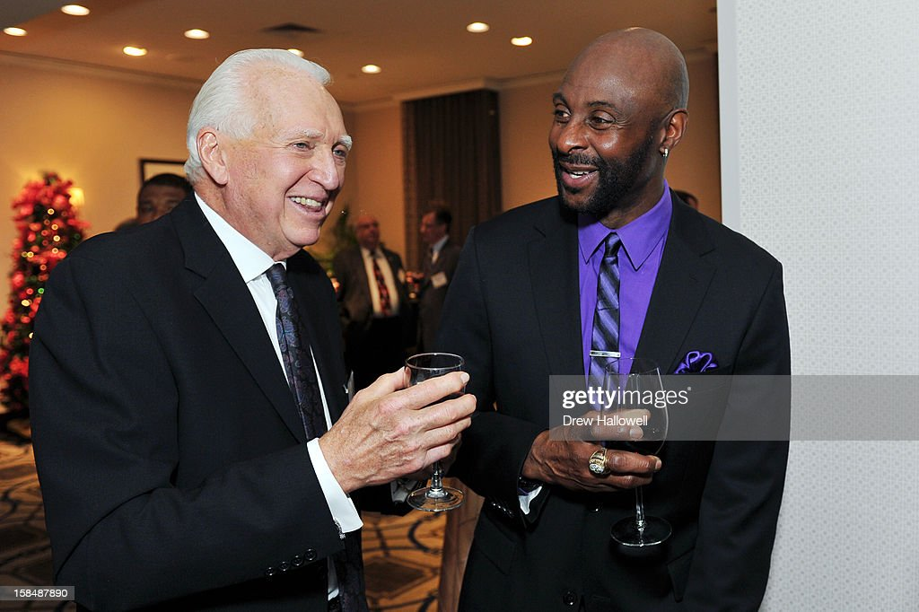 Mickey Charles (L) CEO and President for The Sports Network and former NFL player <a gi-track='captionPersonalityLinkClicked' href=/galleries/search?phrase=Jerry+Rice&family=editorial&specificpeople=184559 ng-click='$event.stopPropagation()'>Jerry Rice</a> talk before presentations during the Sports Network's 26th Annual FCS Awards Presentation at the Sheraton Society Hill on December 17, 2012 in Philadelphia, Pennsylvania.