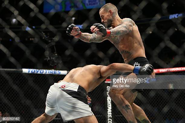 Mickey Gall looks to take down CM Punk during the UFC 203 event at Quicken Loans Arena on September 10 2016 in Cleveland Ohio