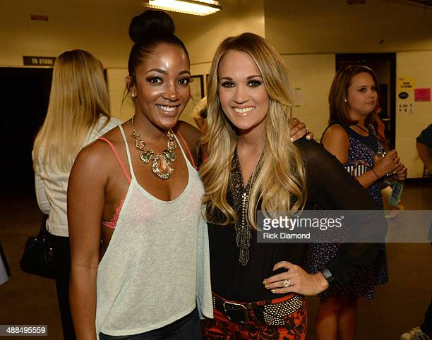 Mickey Guyton and Carrie Underwood attend Keith Urban's Fifth Annual 'We're All 4 The Hall' Benefit Concert at the Bridgestone Arena on May 6 2014 in...