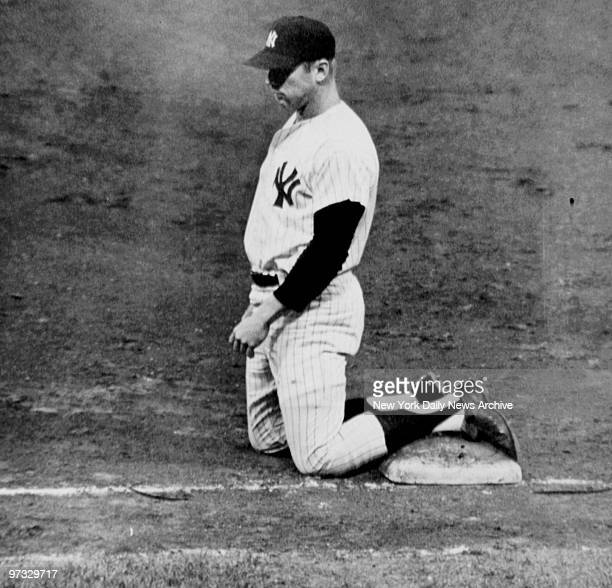 Mickey Mantle kneels on first base after he was doubled up on Joe Pepitone's line out during the New York Yankees and Chicago White Sox game at...