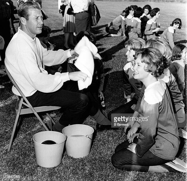 Mickey Mantle of the New York Yankees sits with teenage contestants that will make up a football team on October 29 1963 in Dallas Texas