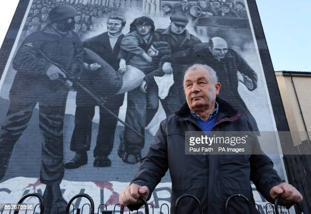 Mickey McKinney whose brother William was killed on Bloody Sunday stands beside a mural in the Bogside area of Londonderry Northern Ireland