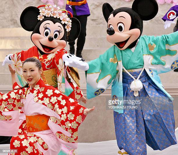 Mickey Minnie Mouse and dancers dressed in kimono dresses perform on the stage at a New Year's event at the Tokyo DisneySea 01 January 2006 Some...
