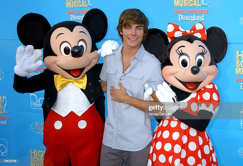 Mickey Mouse, actor <a gi-track='captionPersonalityLinkClicked' href=/galleries/search?phrase=Zac+Efron&family=editorial&specificpeople=533070 ng-click='$event.stopPropagation()'>Zac Efron</a> and Minnie Mouse arrive at Disney's 'High School Musical 2' world premiere at Downtown Disney on August 14, 2007 in Anaheim, California.