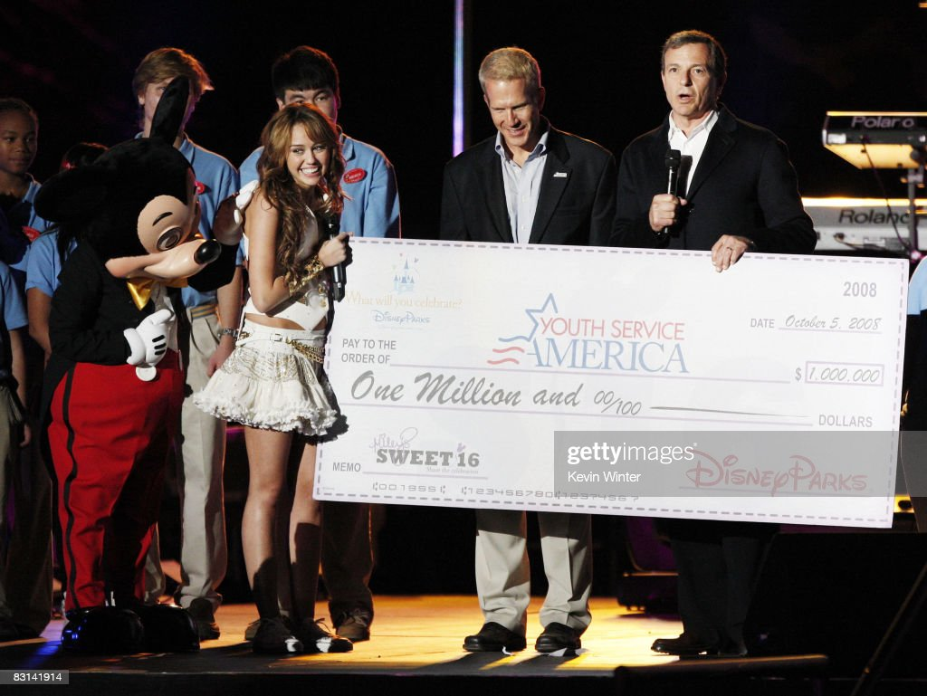 Mickey Mouse, actress/singer Miley Cyrus, YSA CEO Steve Culbertson and Walt Disney Company's Bob Iger appear onstage at Miley Cyrus' 'Sweet 16' birthday celebration benefiting Youth Service America at Disneyland on October 5, 2008 in Anaheim, California.