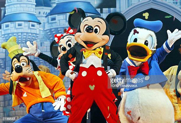 Mickey Mouse and other Walt Disney characters perform during the opening ceremony in Tokyo 18 November 2003 to launch a 24hour exclusive 'Disney...