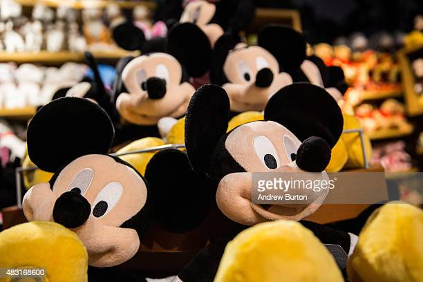 Mickey Mouse dolls are displyed in the Disney store in Times Square on August 6 2015 in New York City Stock prices of media companies including...