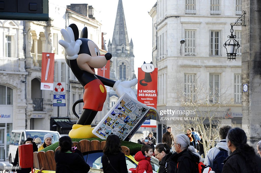A Mickey mouse giant figurine is exhibited in the streets on the last day of the Comic book festival of Angouleme on February 3, 2013 in Agouleme, western France. The awards ceremony will take place today. AFP PHOTO JEAN PIERRE MULLER
