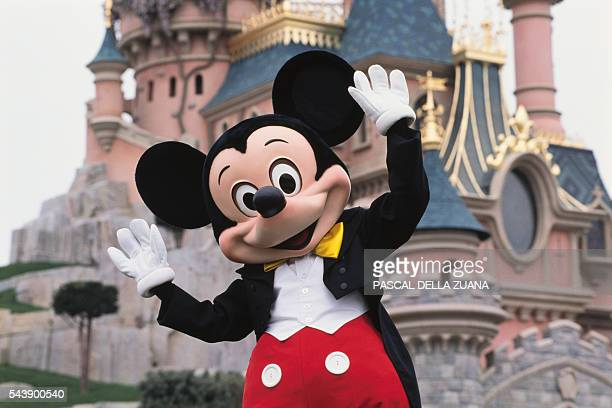 Mickey Mouse in front of the Sleeping Beauty Castle at Disneyland Resort Paris