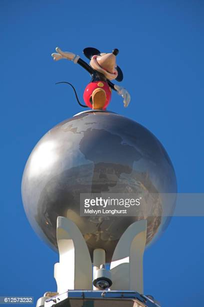 Mickey Mouse standing on globe of the world, at entrance to Disney MGM Studios, Orlando, Florida, USA