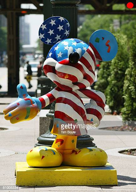 Mickey Mouse statue titled 'Mickey Celebrates Our Freedom' designed by Paul Wenzel stands along State Street June 28 2004 in Chicago Illinois This is...