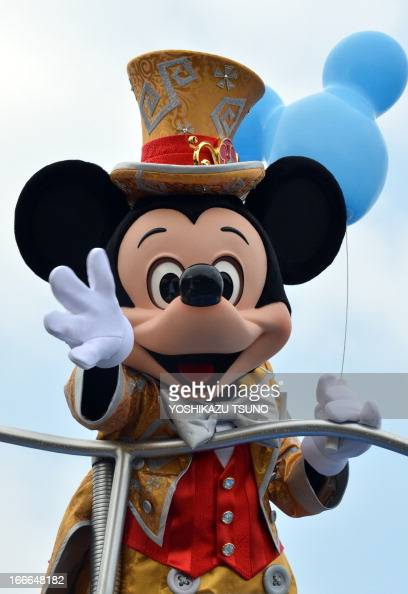 Mickey Mouse waves his hand from a float for the parade as the Tokyo Disneyland celebrates its 30th anniversary in Urayasu suburban Tokyo on April 15...