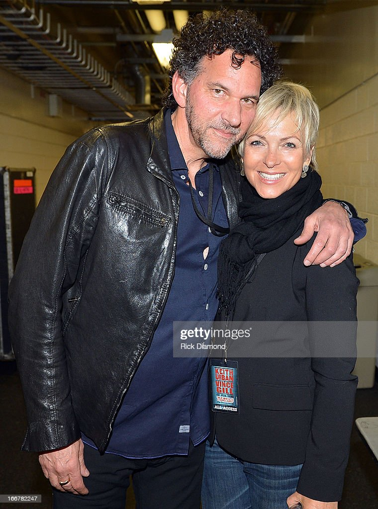 Mickey Raphael and Brenda Price backstage during Keith Urban's Fourth annual We're All For The Hall benefit concert at Bridgestone Arena on April 16, 2013 in Nashville, Tennessee.