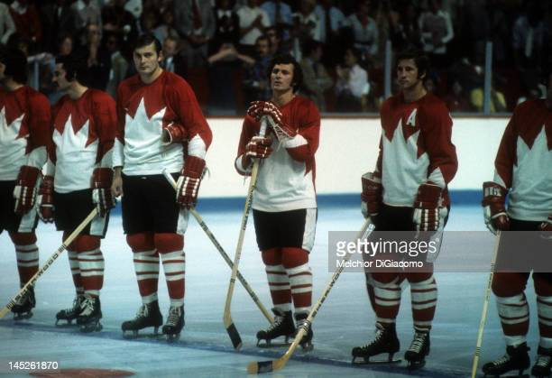 Mickey Redmond Pete Mahovlich Paul Henderson and Jean Ratelle of Canada stand on the ice before Game 1 of the 1972 Summit Series against the Soviet...