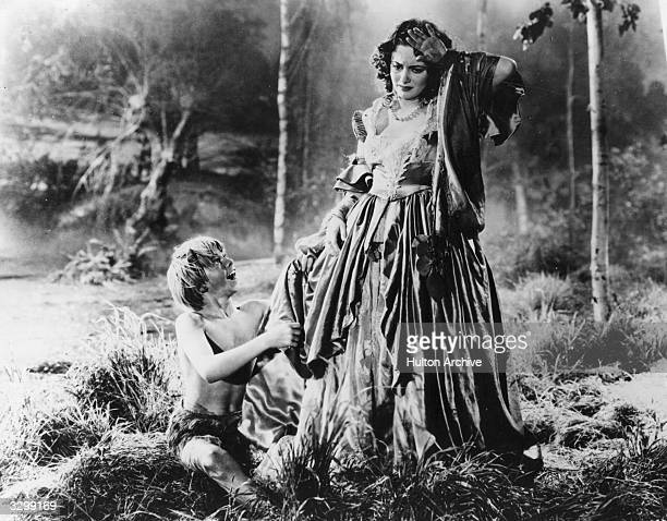 Mickey Rooney as Puck and Olivia De Havilland as Hermia in a scene from Shakespeare's 'A Midsummer Night's Dream' directed by Max Reinhardt and...