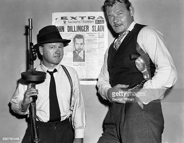 Mickey Rooney as the notorious 1930s gangster Baby Face Nelson starring in the film of the same name poses with Leo Gordon as villainous bank robber...