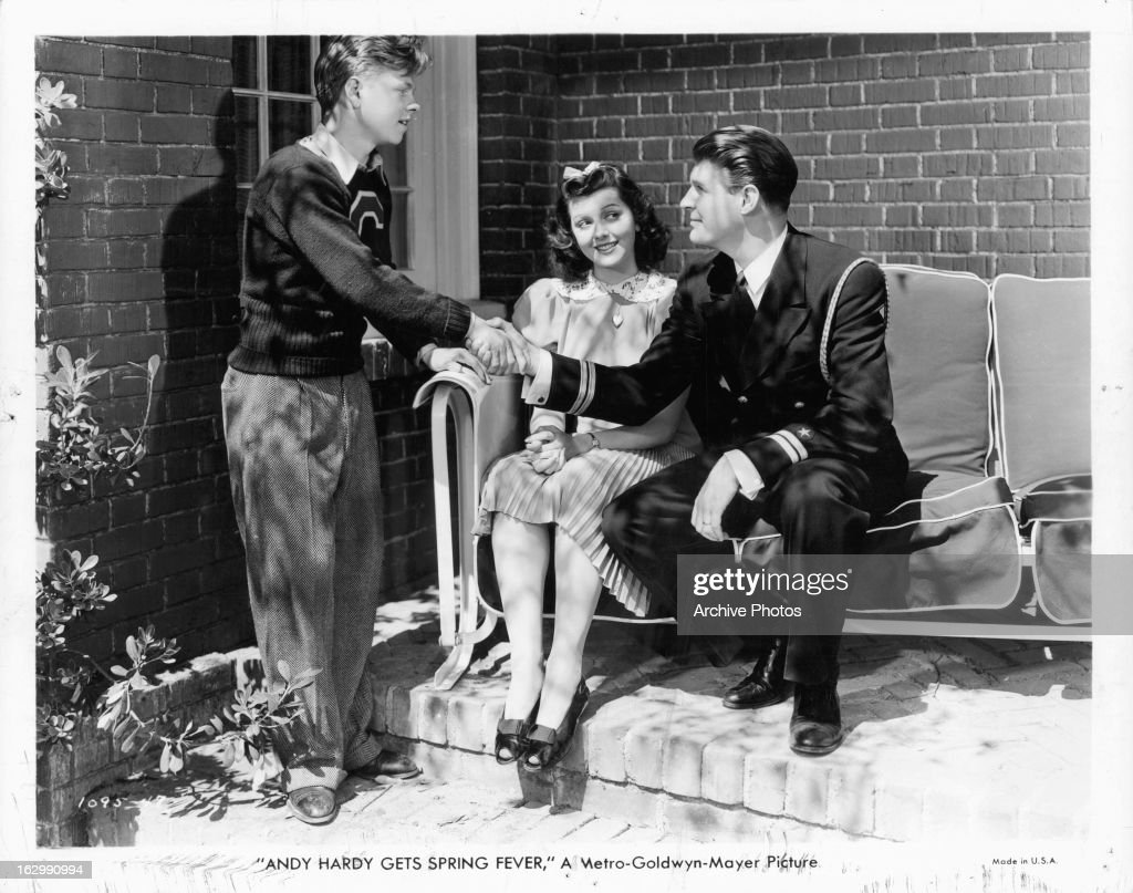 <a gi-track='captionPersonalityLinkClicked' href=/galleries/search?phrase=Mickey+Rooney&family=editorial&specificpeople=91553 ng-click='$event.stopPropagation()'>Mickey Rooney</a> shakes a man's hand in a scene from the film 'Andy Hardy Gets Spring Fever', 1939.